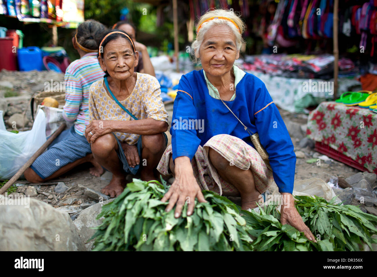 Hanunoo Mangyan women selling their crops at a Mangyan market near Mansalay, Oriental Mindoro, Philippines. Stock Photo