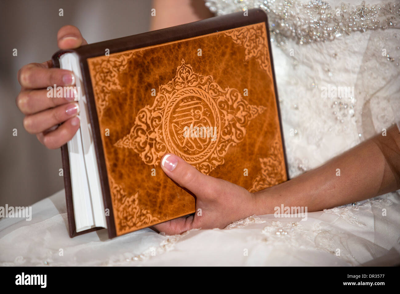 A bride holding a copy of the Koran during an Iranian wedding ceremony. - Stock Image