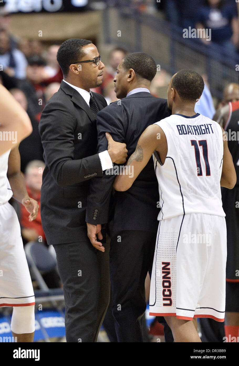 Storrs, CT, USA. 18th Jan, 2014. Saturday January 18, 2014: Connecticut Huskies Head coach Kevin Ollie is restrained Stock Photo