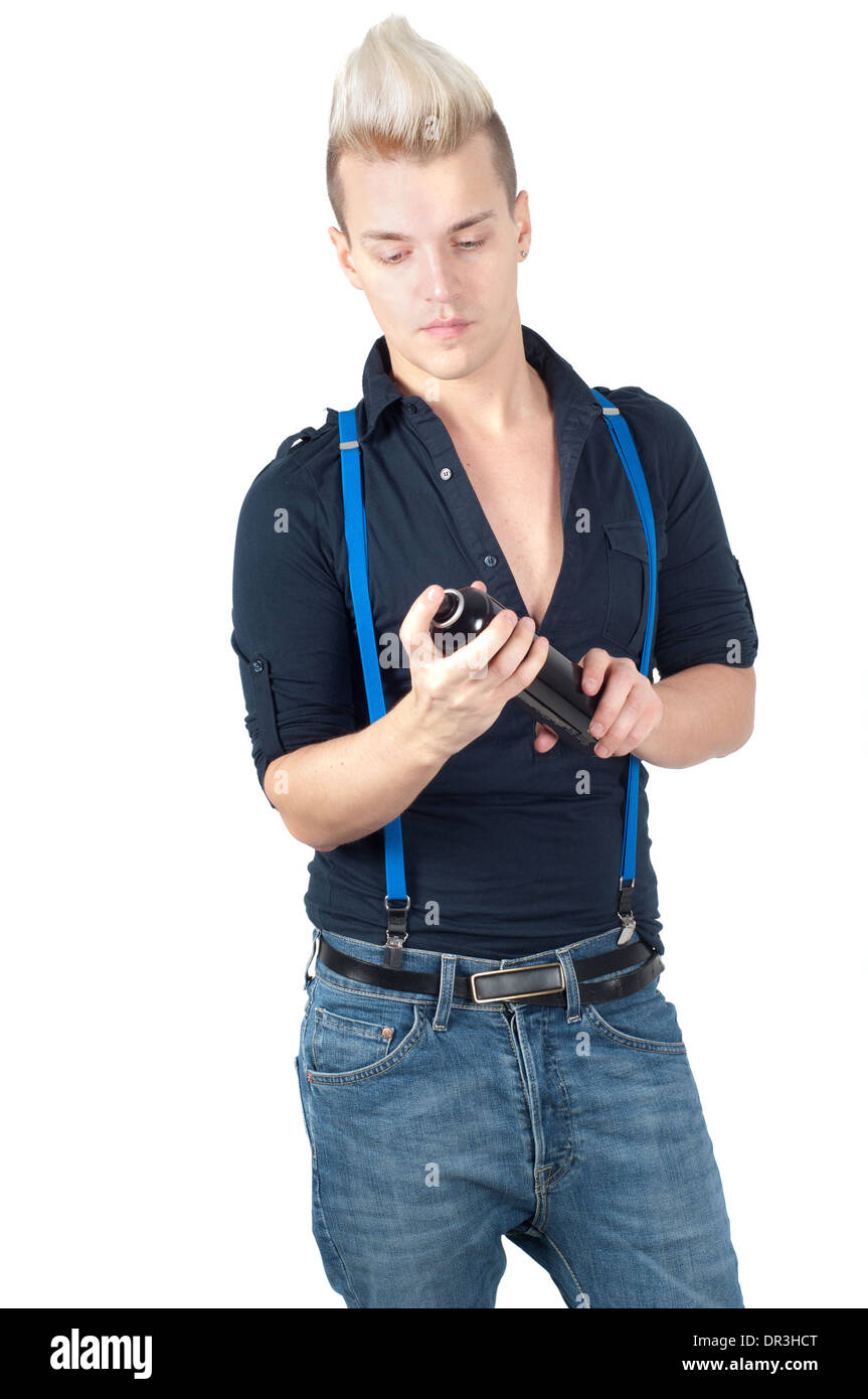 Handsome man in jeans and suspenders - Stock Image