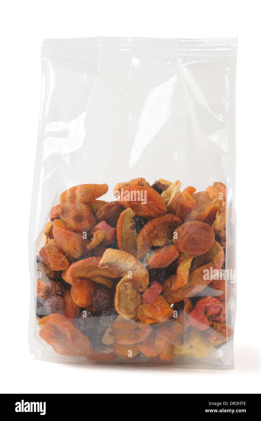 Mixed dried fruits in transparent packing over white - Stock Image