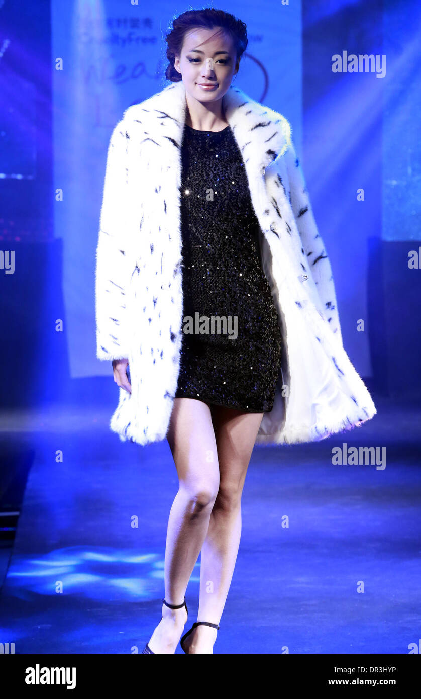 Beijing, China. 19th Jan, 2014. A model presents a creation by South Korean designer Gee-eun Lee during the Cruelty Stock Photo