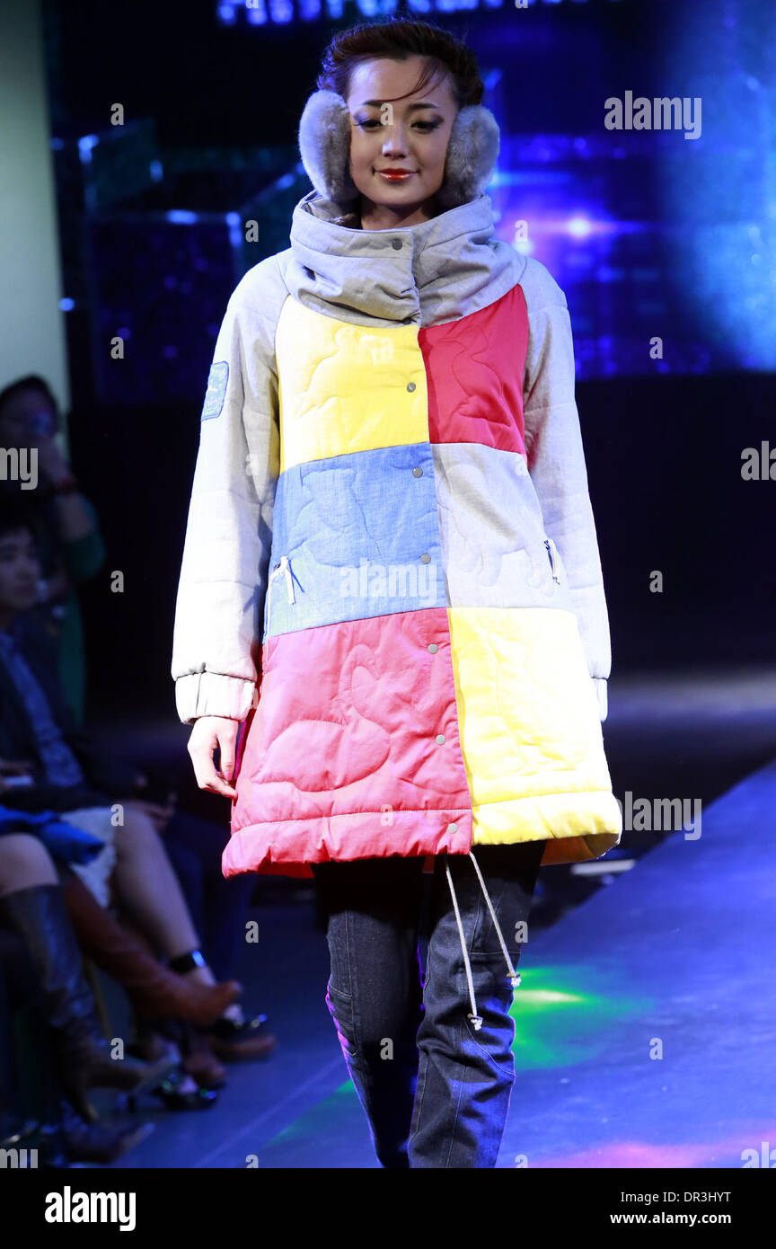 Beijing, China. 19th Jan, 2014. A model presents a creation by American designer Leanne Mai-Ly Hilgart during the Stock Photo