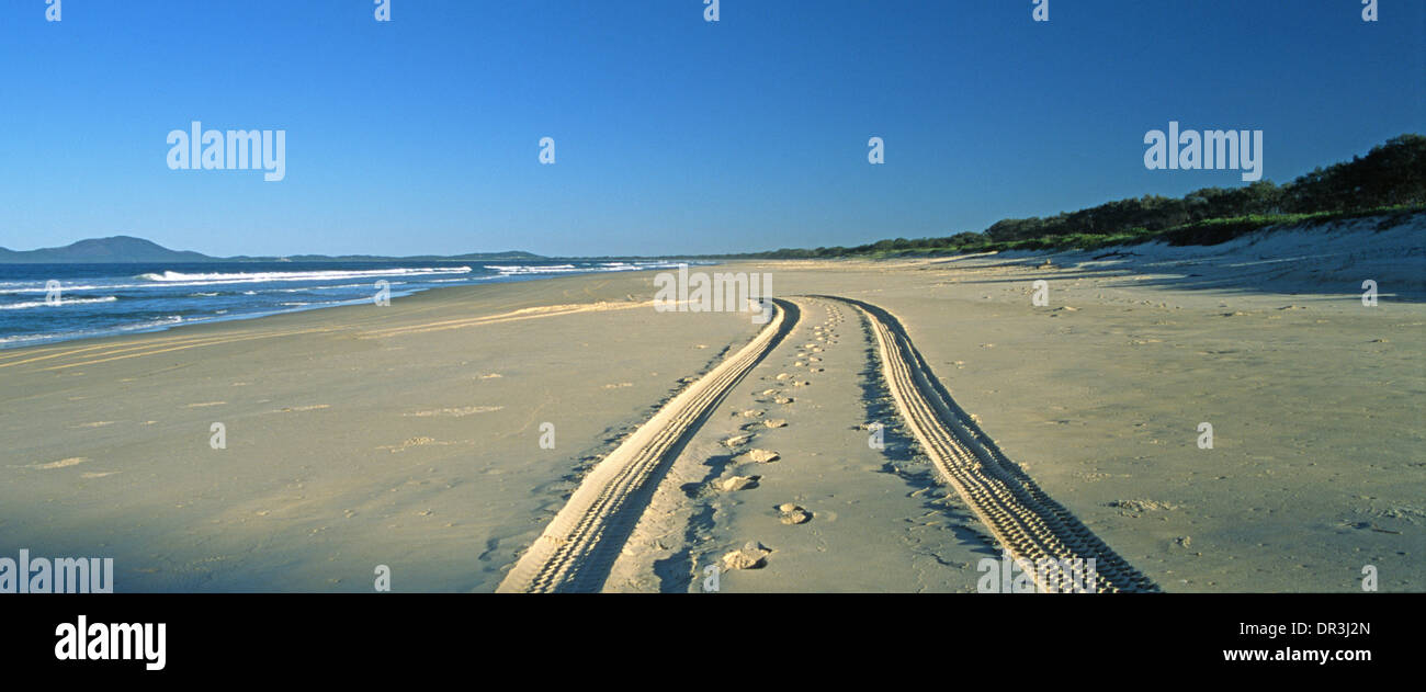 Tracks on a deserted Australian beach are the only sign of human intrusion. - Stock Image