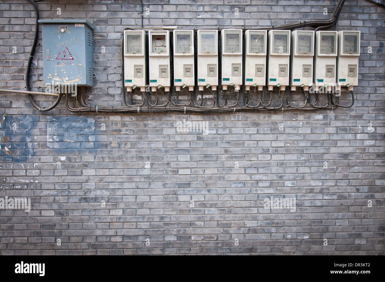 electricity meters and fuse boxes in hutong area, beijing, china - stock  image