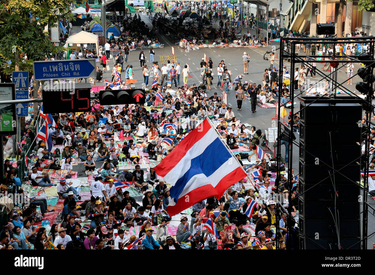 Bangkok, Thailand. 19 Jan 2014. Location in these images is in the centre of Bangkok an area known as 'Ratchaprasong' opposite the huge Centralworld shopping mall & revered Erawan Shrine.  Normally filled with traffic it has been converted to campsite with great views and live entertainment. Tens of thousands of protesters have disrupted traffic at major intersections and marched on government offices in Thailand's large and hectic capital city this week. The protests, dubbed 'Bangkok Shutdown,' had begun Monday 13th January without serious incident.  The rallies are orchestrated by the Peo ©  - Stock Image