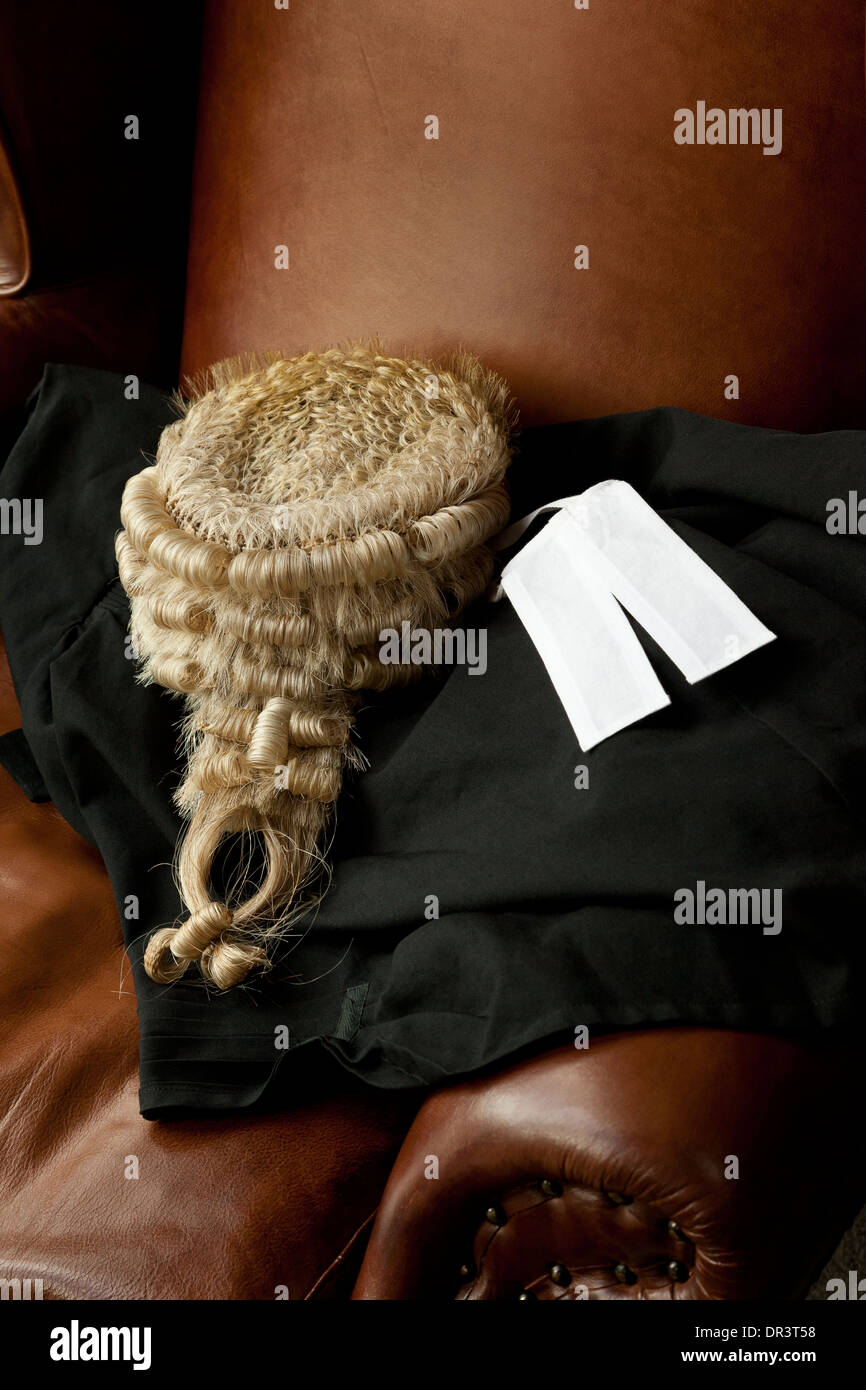 A Barrister\'s wig, Bands and Gown lying on a leather winged back ...