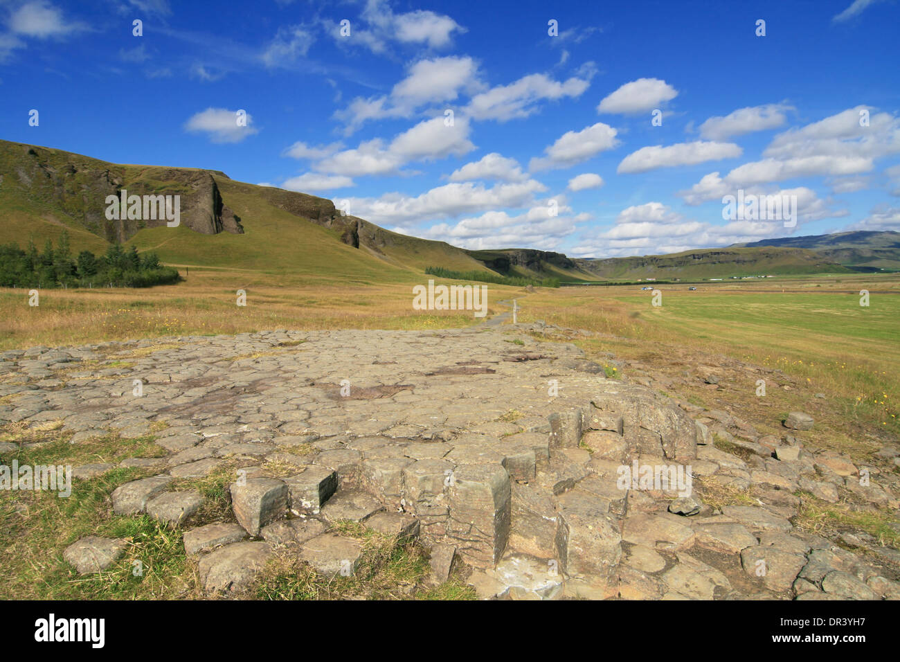 Pavement of columnar basalt in pentagonal shapes near Kirkjubaerjarklaustur in Southern Iceland. - Stock Image