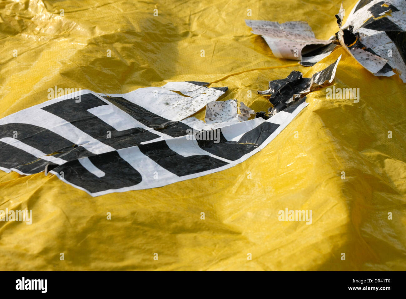 Yellow mass casualty transport incident blanket worn with words Delayed - Stock Image