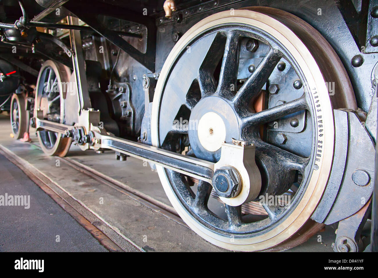 Fragment of the steam engine of the old train - Stock Photo