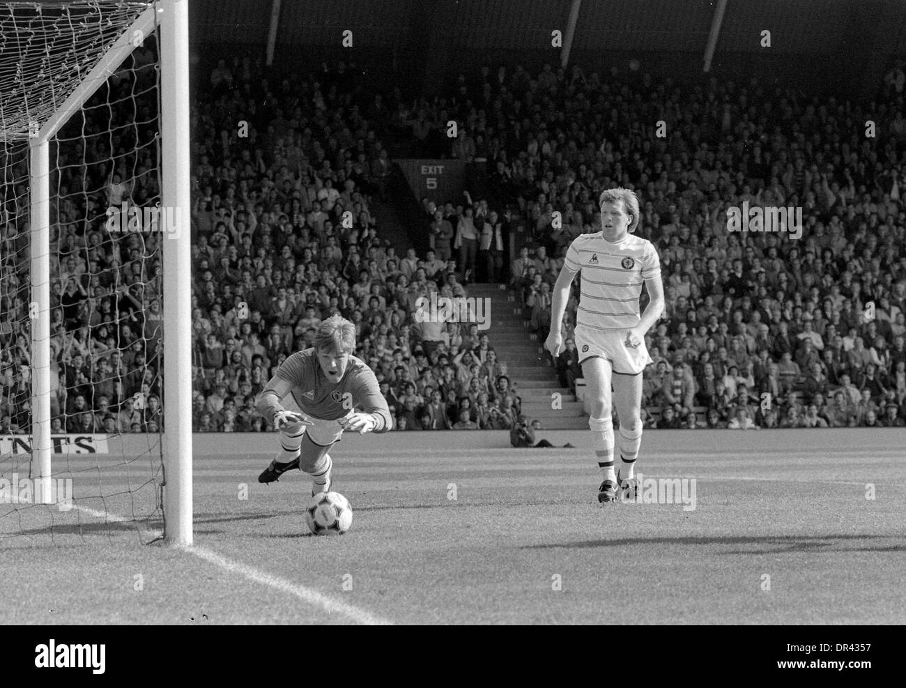 LIVERPOOL V ASTON VILLA 17/9/1983 Goalkeeper Nigel Spink saves watched by Brendan Ormsby - Stock Image