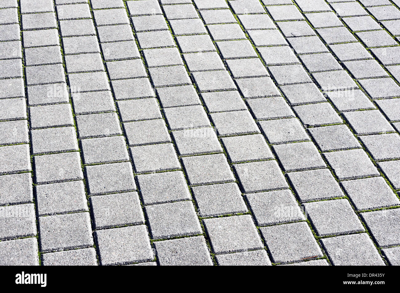background with floor tiles of granite paving stones - Stock Image