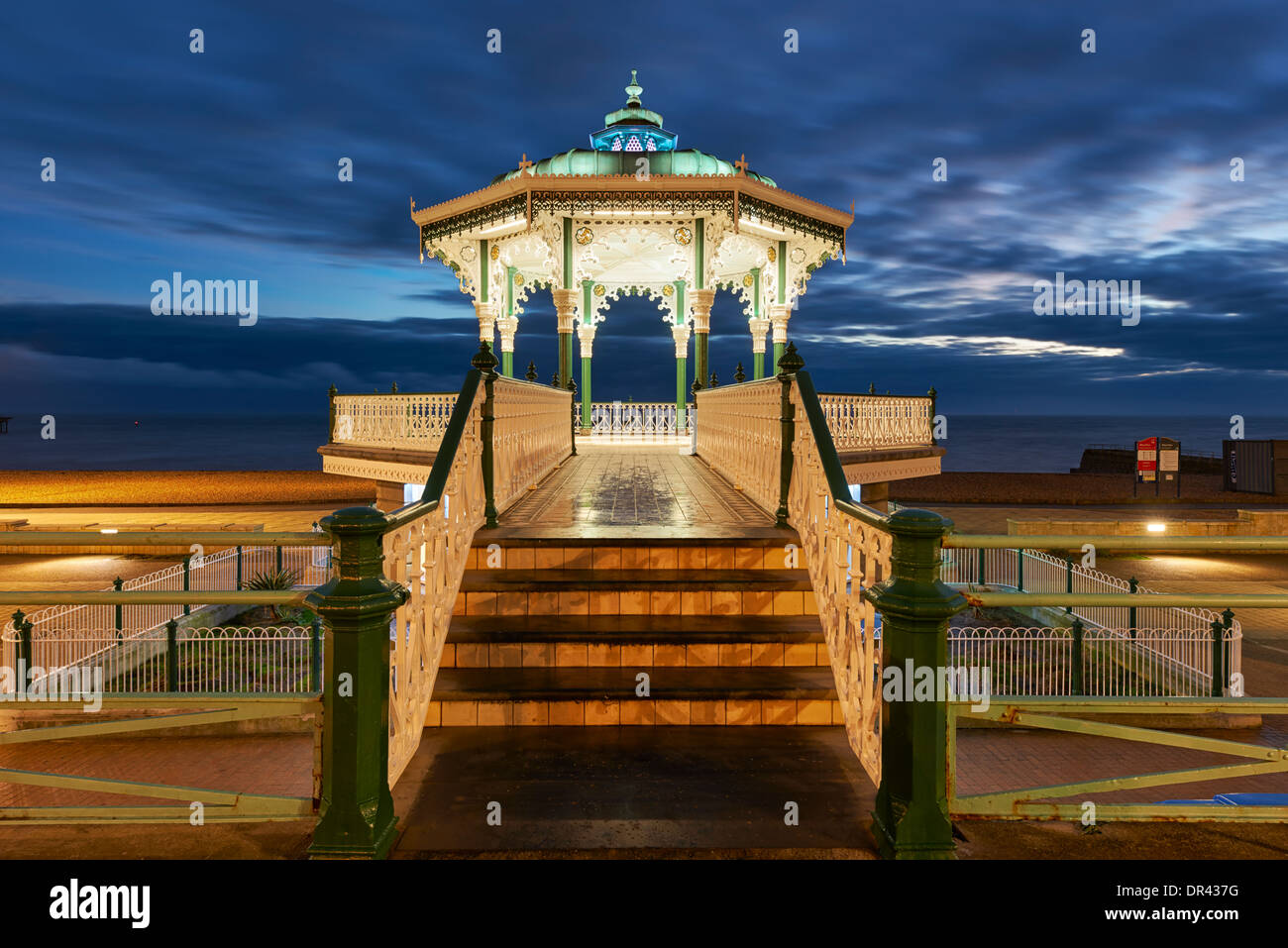 Brighton bandstand illuminated at twilight - Stock Image