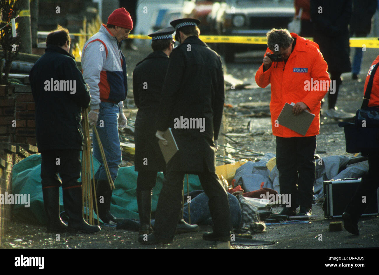 Lockerbie plane crash Pan Am Flight 103 police survey wreckage and photograph one of the victims of the terrorist attack 22/12/8 - Stock Image