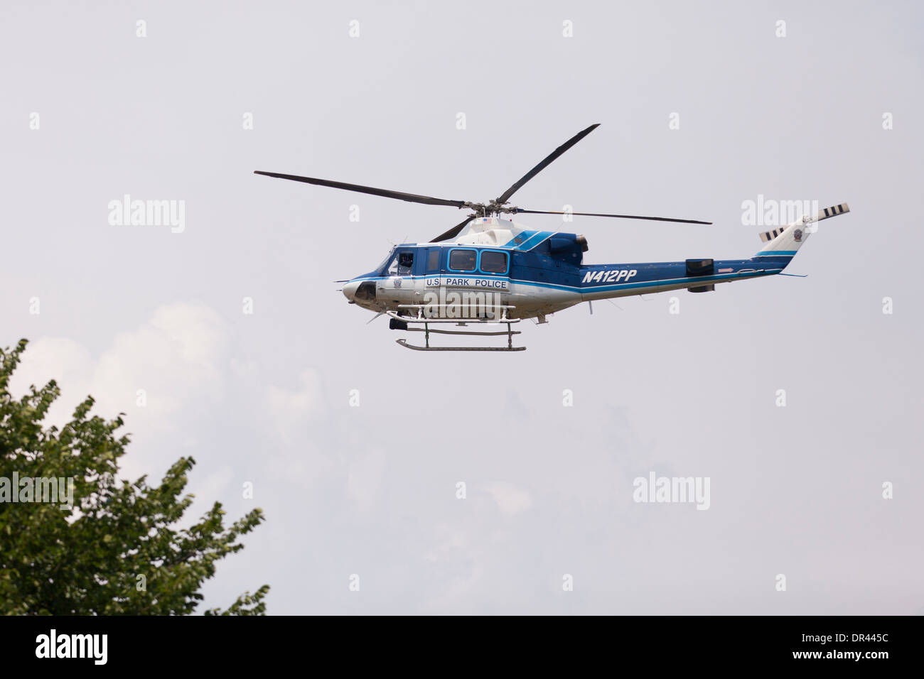 US Park Police Bell 412SP helicopter in flight - USA - Stock Image