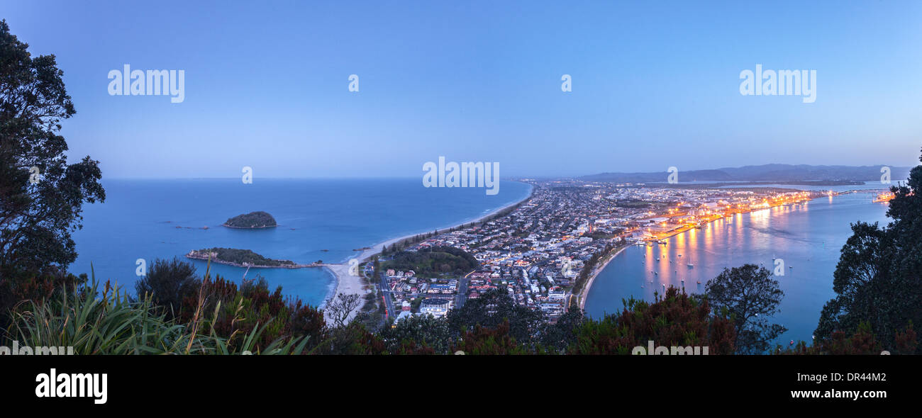 Panoramic view of Mount Maunganui and the Port of Tauranga at nightfall, from the summit of the Mount. - Stock Image