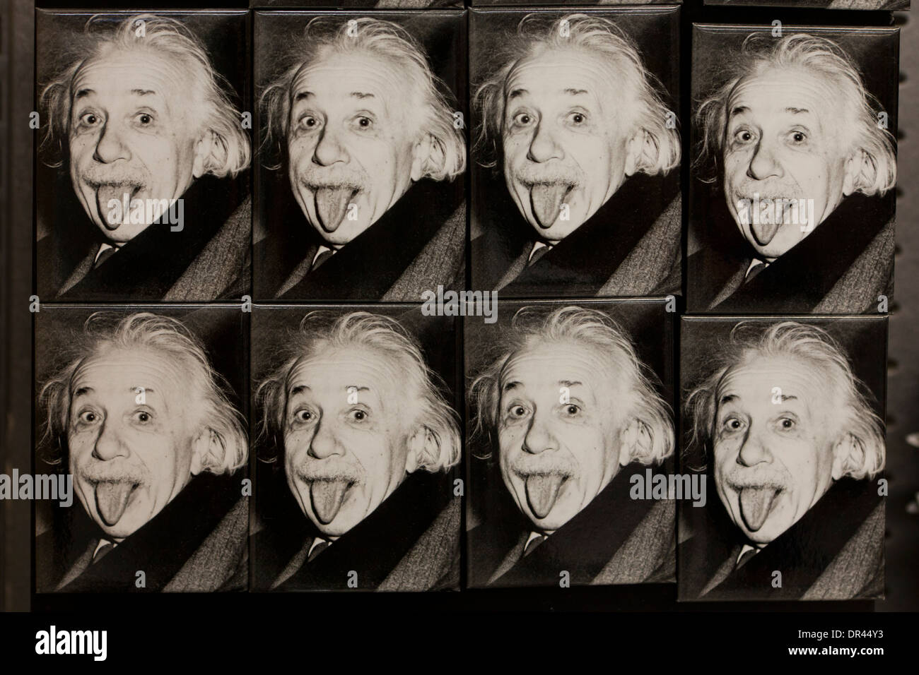 Albert Einstein sticking out tongue photo buttons - Stock Image
