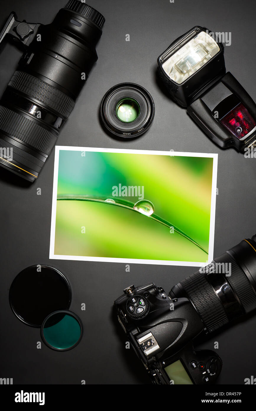 camera and lense on black showing photographer still life - Stock Image