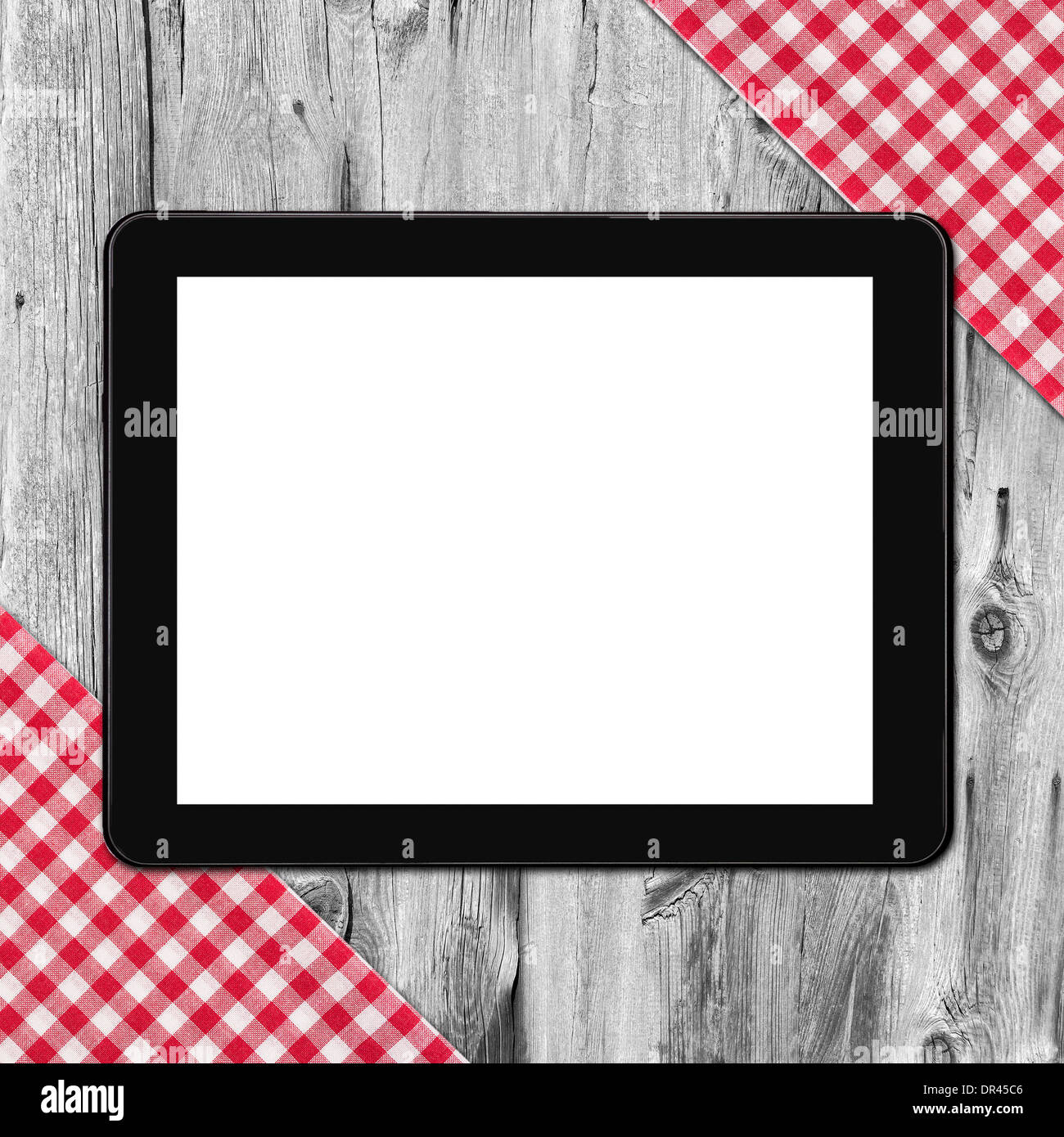 Tablet, tablecloth textile texture on wooden table background - Stock Image