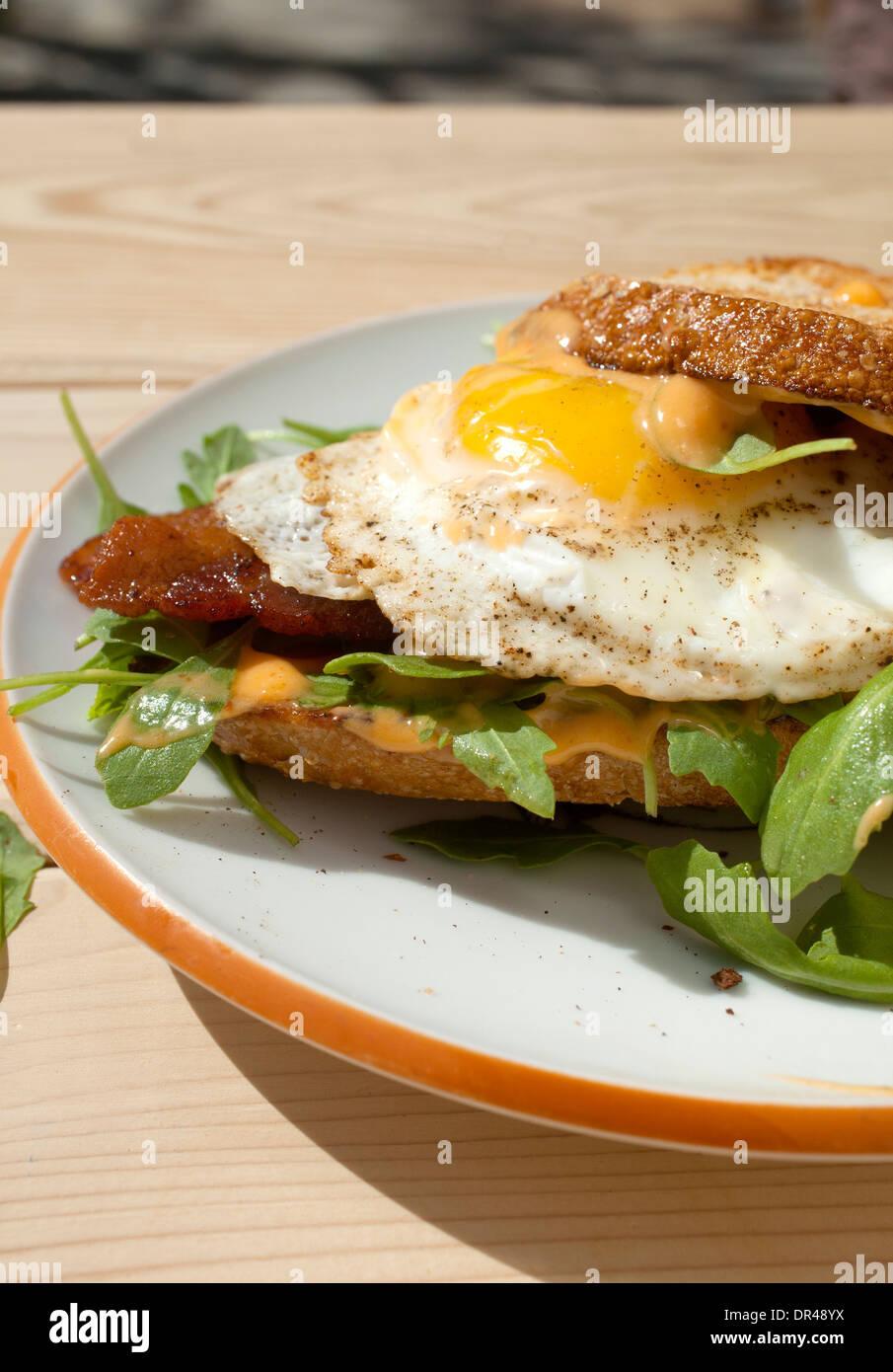 Open faced egg breakfast sandwich - Stock Image