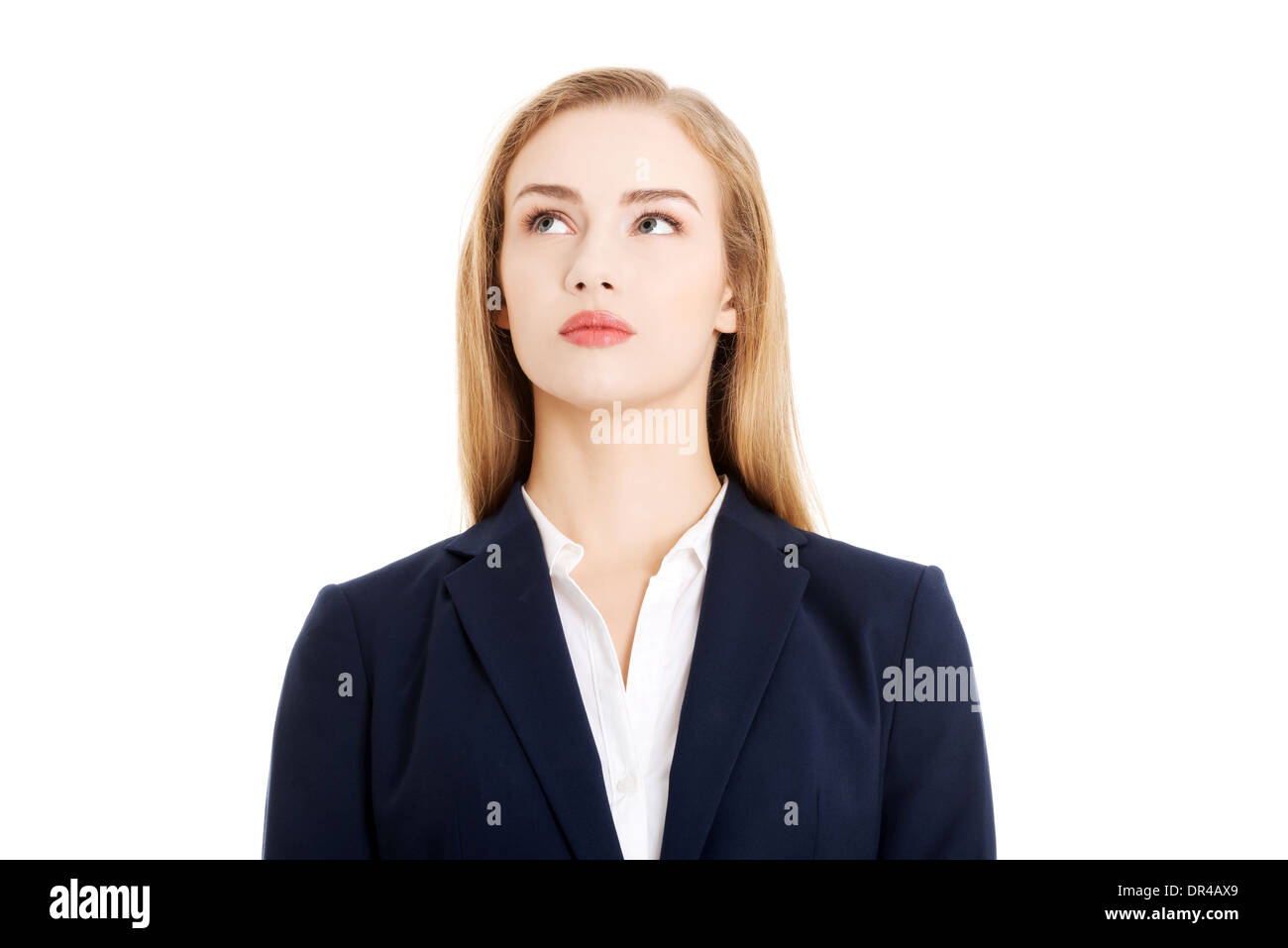 Beautiful business woman looking up at copy space. Isolated on white. - Stock Image