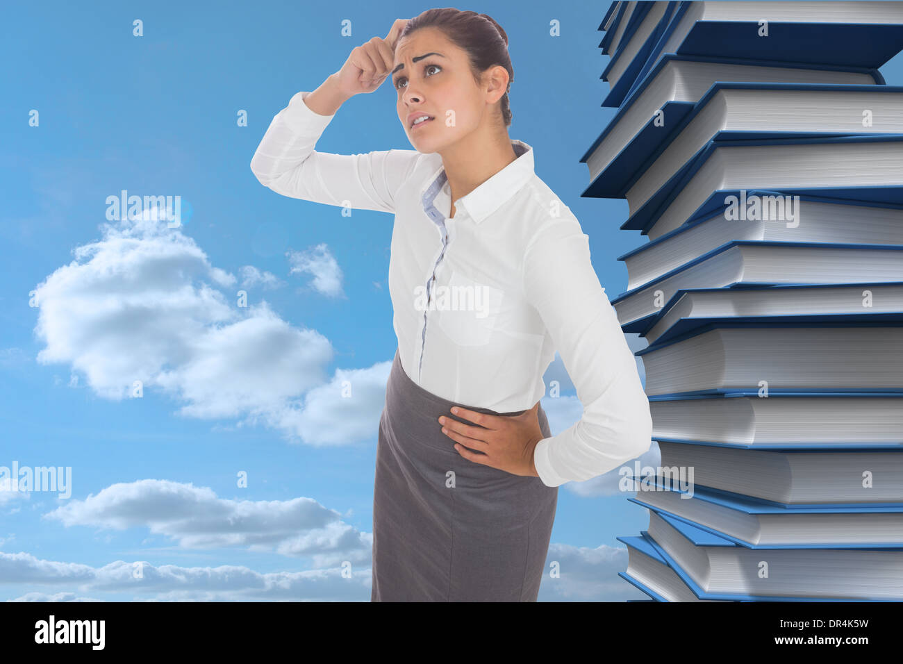 Composite image of worried businesswoman - Stock Image