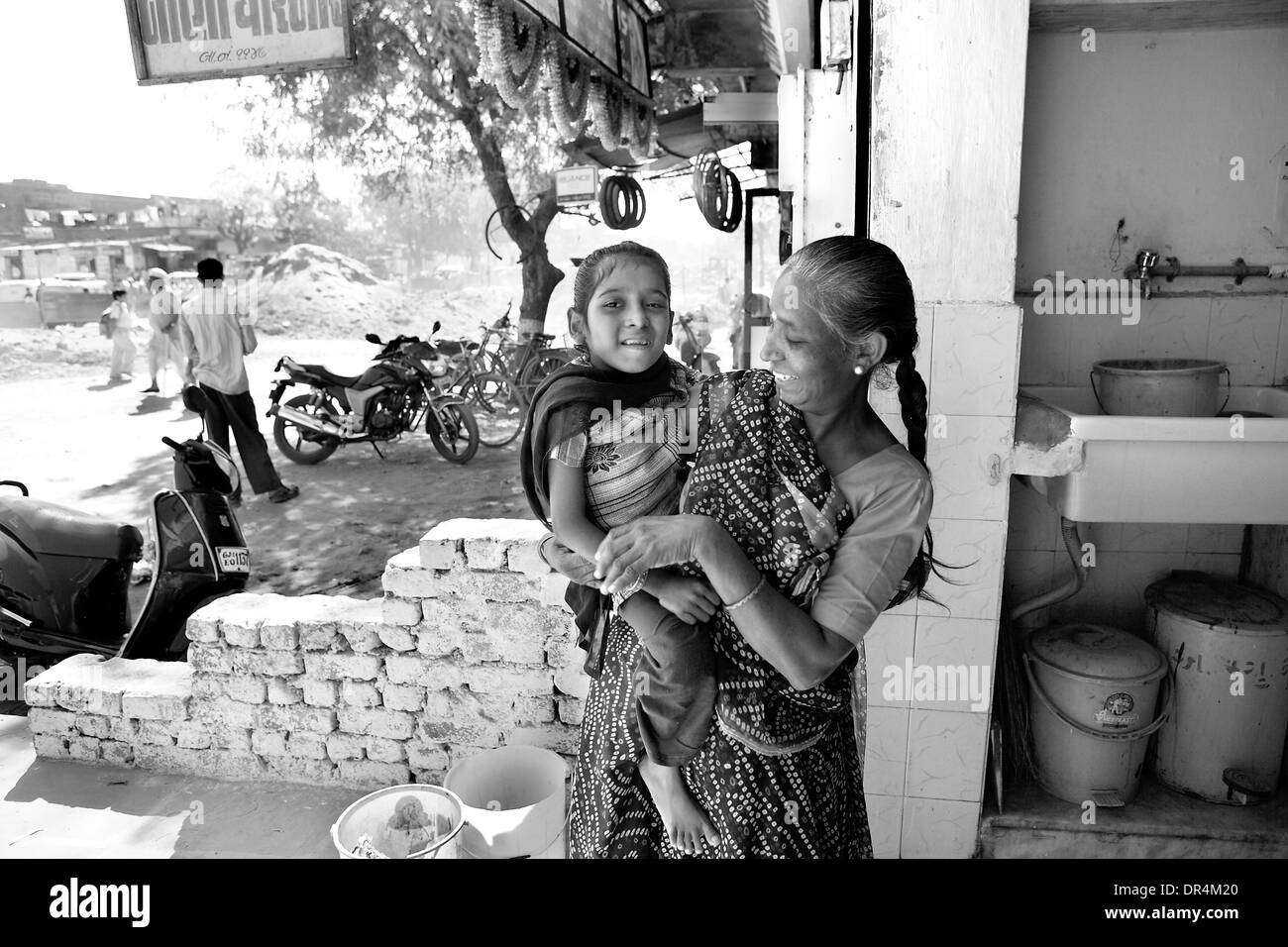 Jan 24, 2009 - DOTS centre,Ahmedabad, Gujarat, India - SANGITABEN SHREEMALI brings her granddaughter MUNNI SHREEMALI at the DOTS centre at Ahmedabad for her dose of TB medicines. Munni suffers from extra pulmonary TB and is on CAT III regime. TB has affected her spinal cord and consequently it has started affecting her eyes as well. (Credit Image: © Subhash Sharma/ZUMA Press) - Stock Image