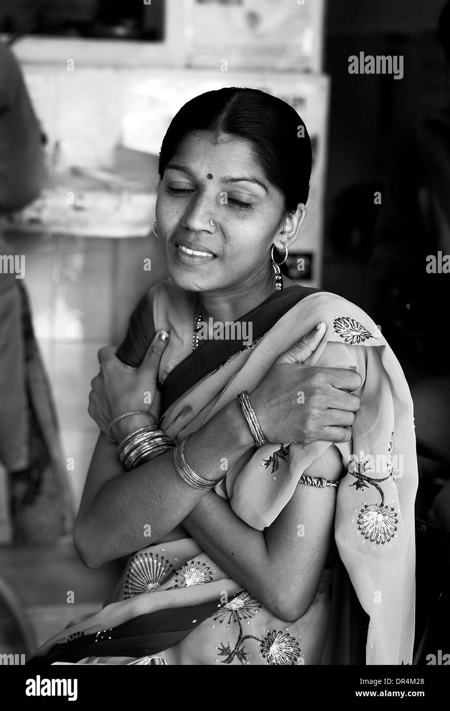 Jan 24, 2009 - DOTS centre,Ahmedabad, Gujarat, India - CHAMCHAMBEN SHARMA shrugs in pain after she is injected with the TB medicine she suffers from MDR-TB,She is enable to come to the fact that though regular with her CAT I and II regimes she has MDR-TB (Credit Image: © Subhash Sharma/ZUMA Press) - Stock Image