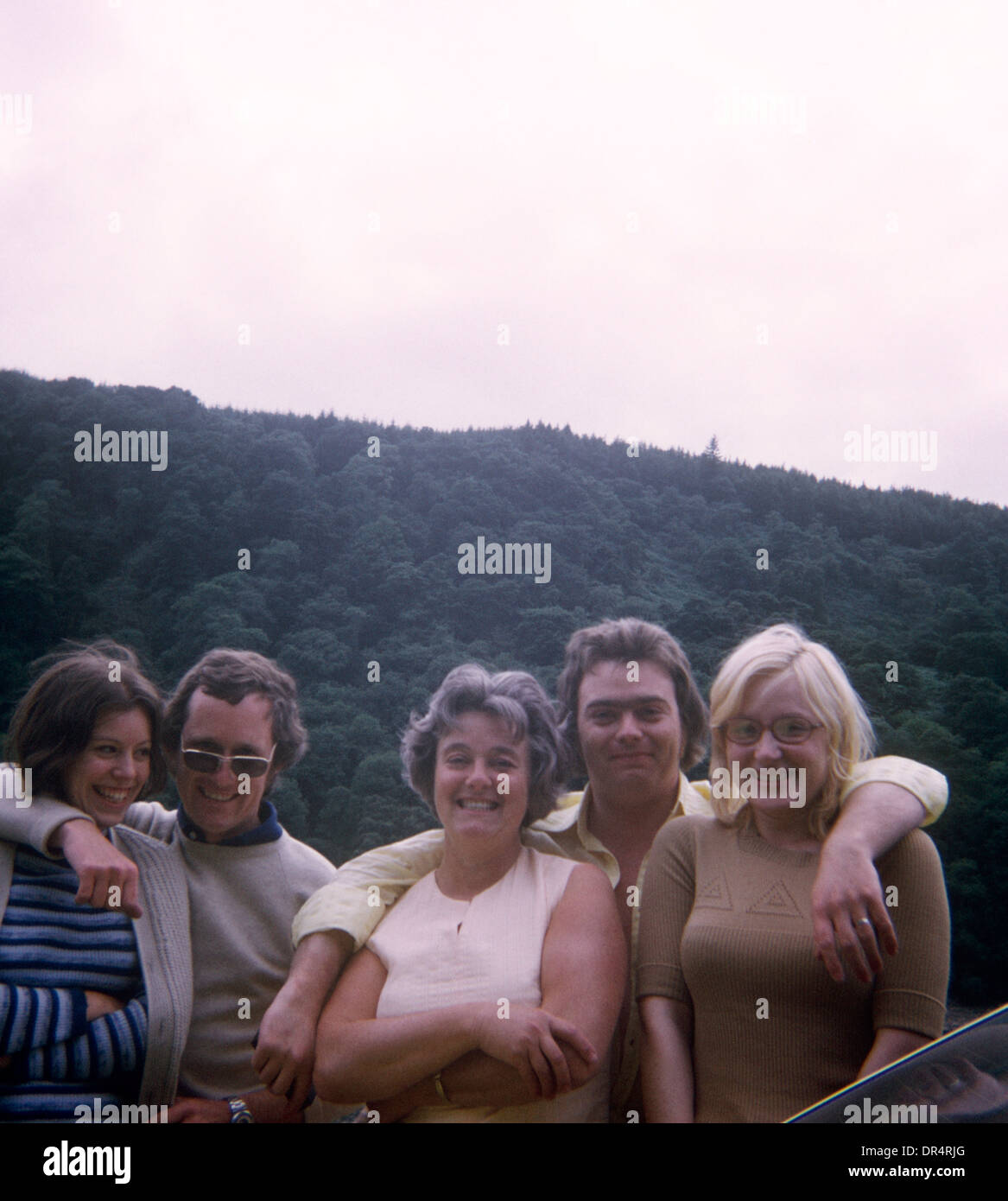 Friends and family portrait with Welsh hills in the background in the 1970s. - Stock Image