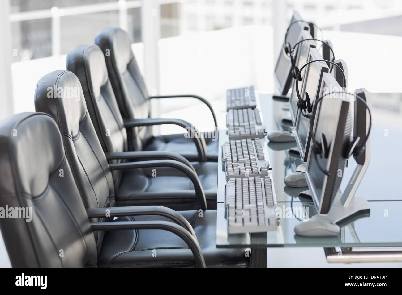 Chairs, computers and headset in a modern office - Stock Image