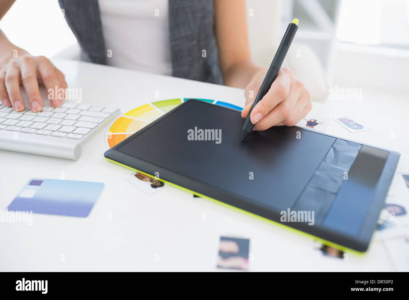 Female photo editor using graphics tablet Stock Photo