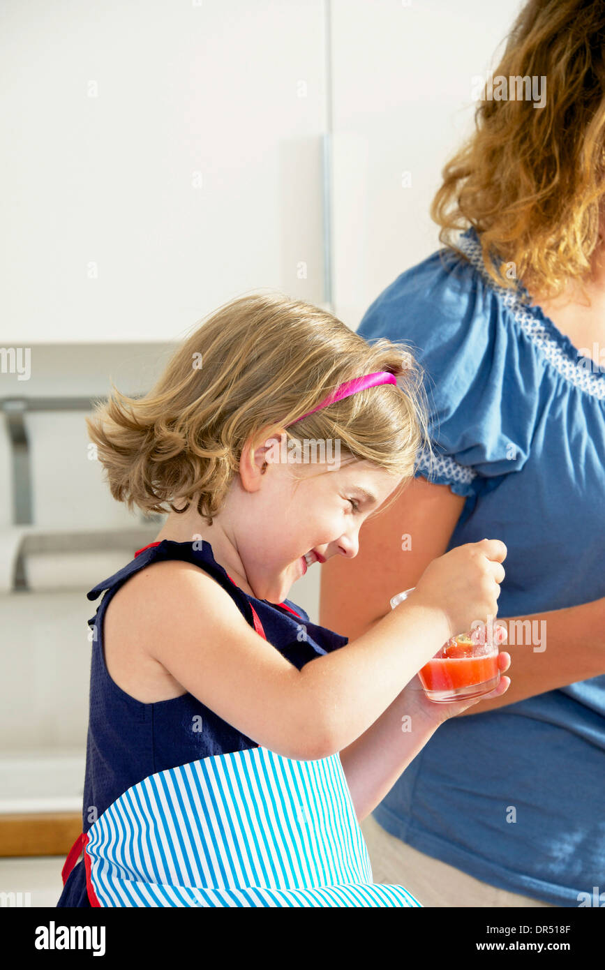 Mother And Daughter In The Kitchen - Stock Image