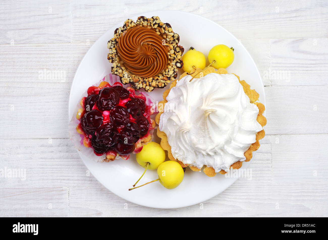 Different cake in a plate on table. Top view & Different cake in a plate on table. Top view Stock Photo: 65879028 ...