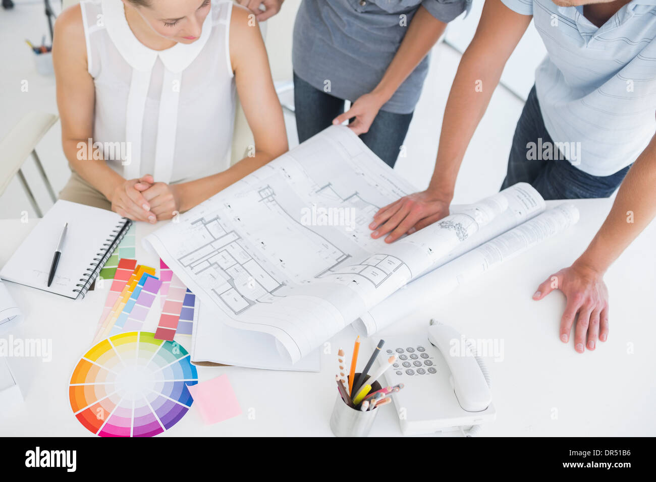 Mid section of artists working on designs - Stock Image