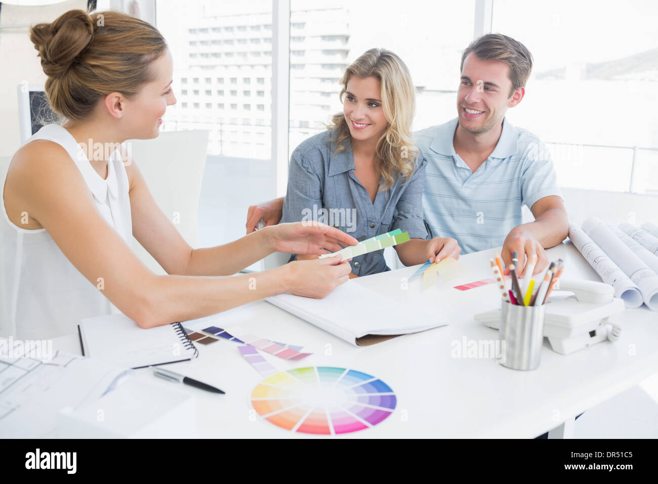 Group of artists working on designs - Stock Image