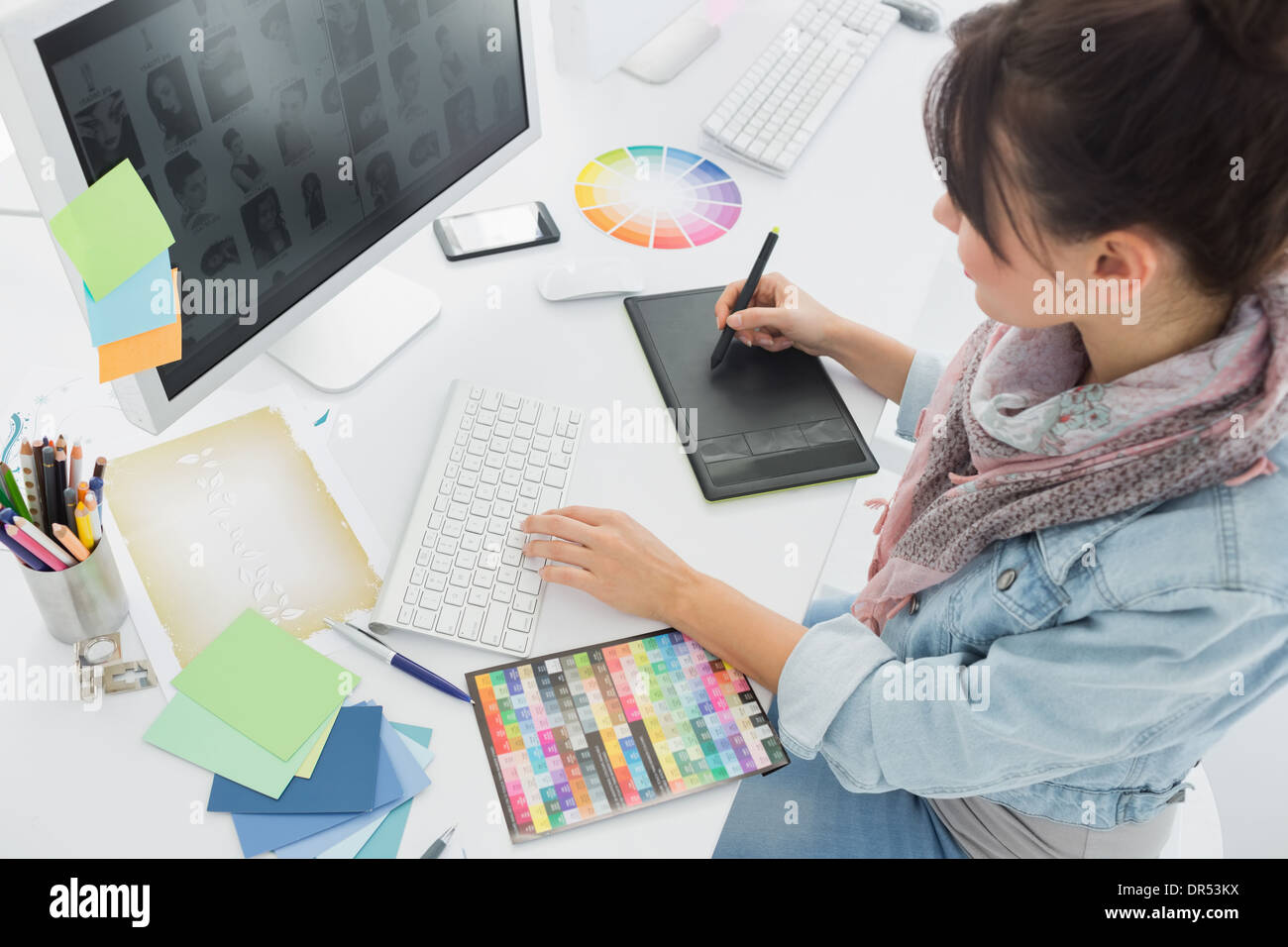 Artist drawing something on graphic tablet at office Stock Photo