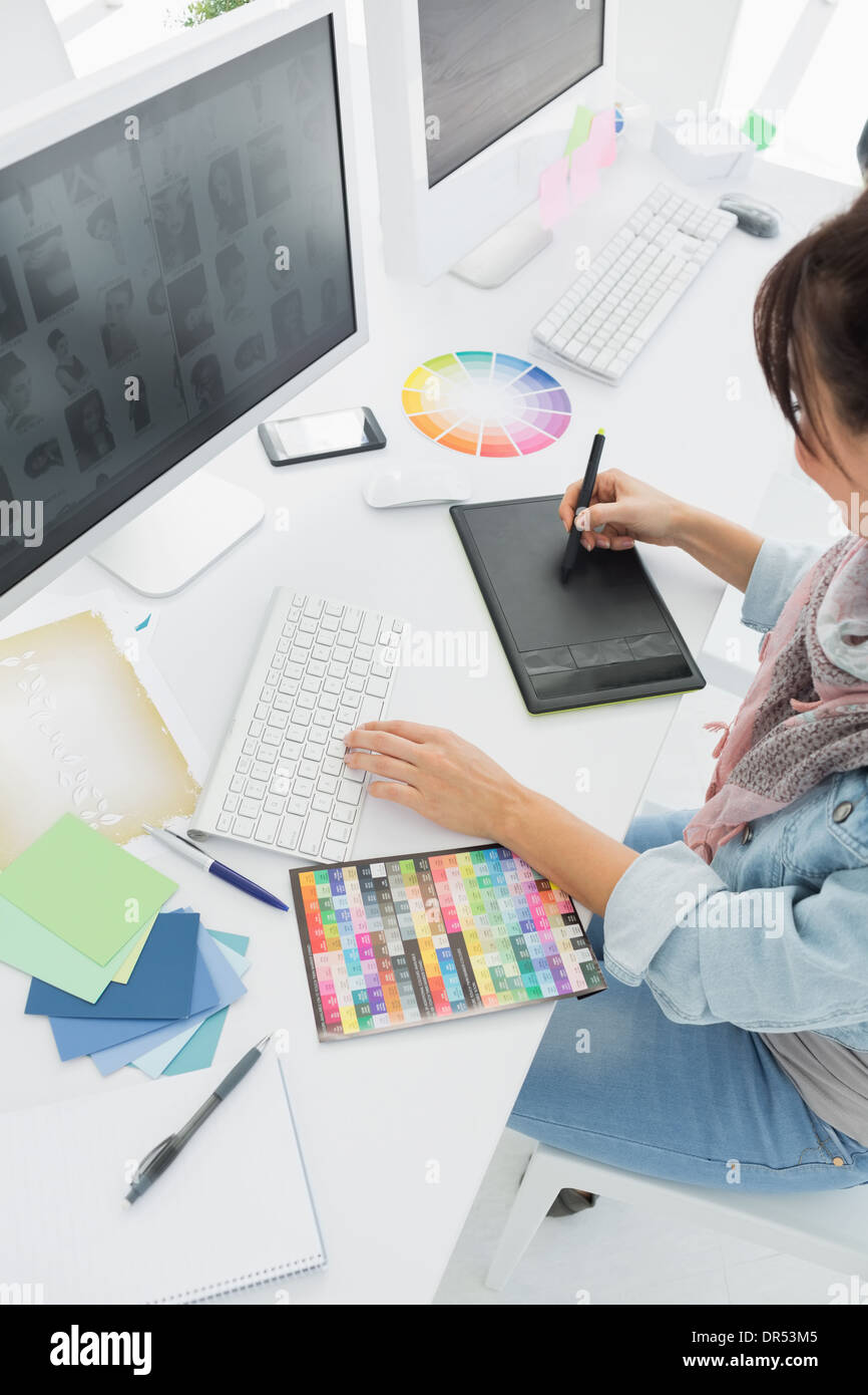 Artist drawing something on graphic tablet - Stock Image