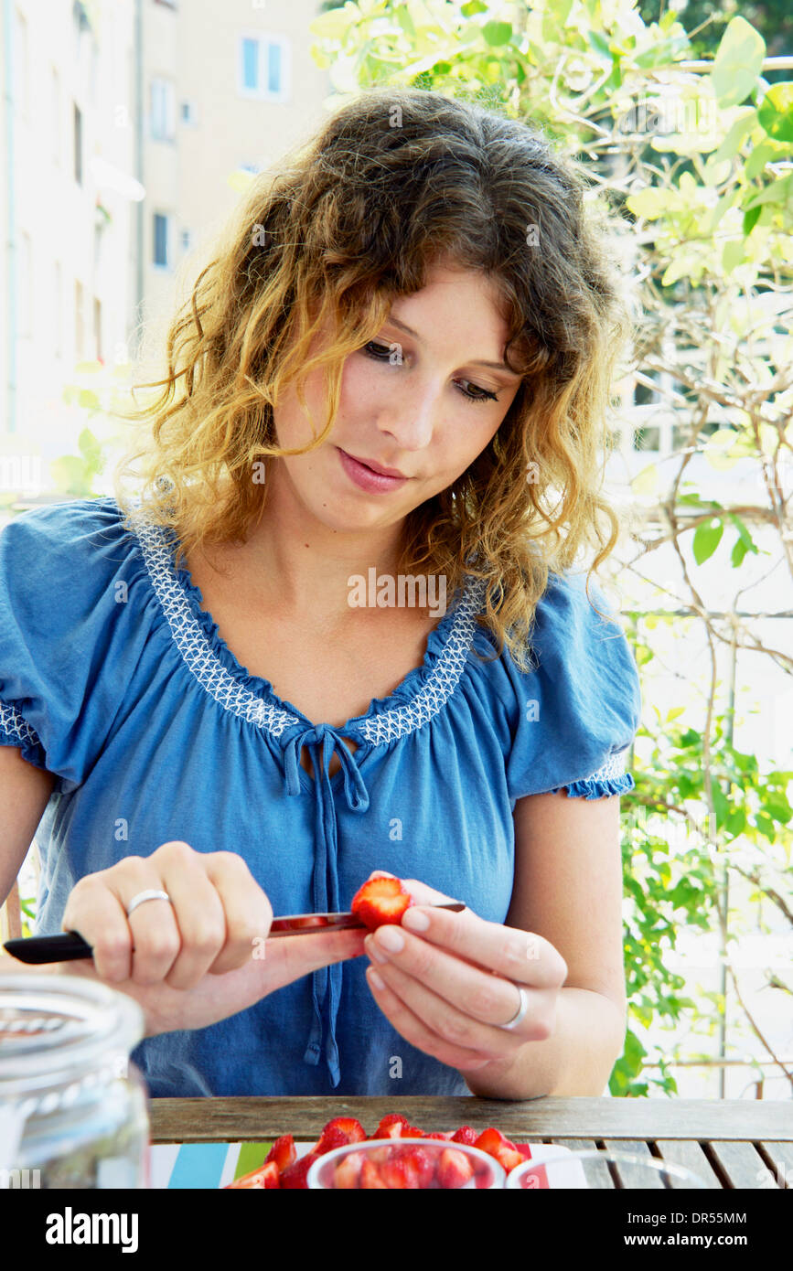 Young Woman Preparing Cold Punch - Stock Image