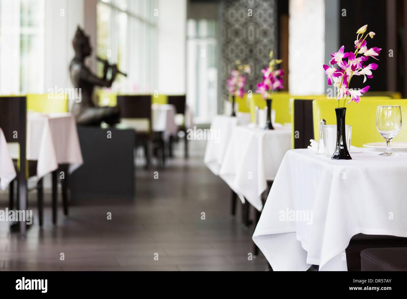 Set tables in Thai restaurant - Stock Image