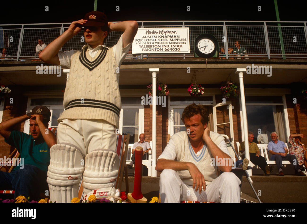 A batsman prepares to walk on to the field during a local club match in Paignton, UK. Stock Photo