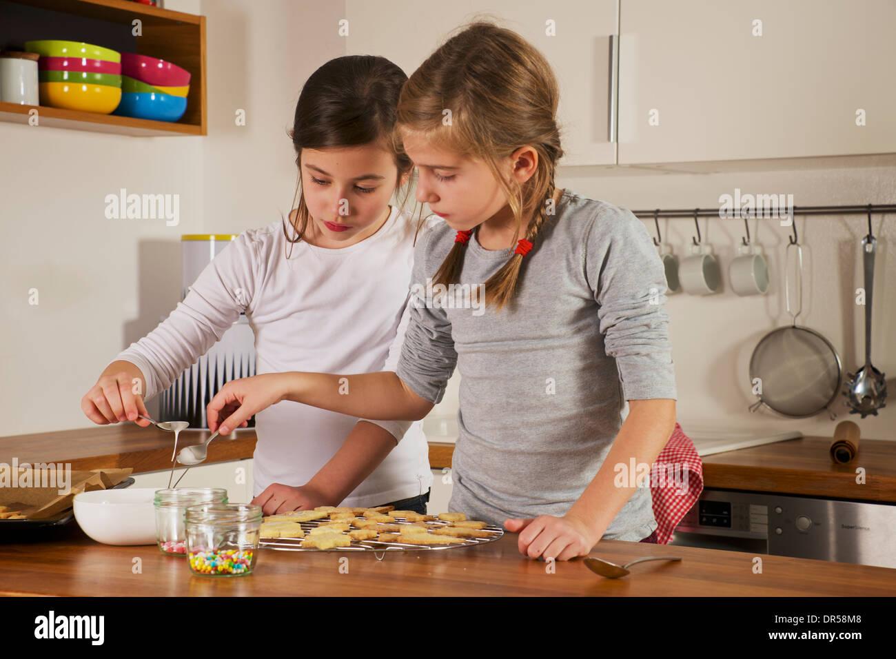 Children making Christmas cookies, Munich, Bavaria, Germany - Stock Image