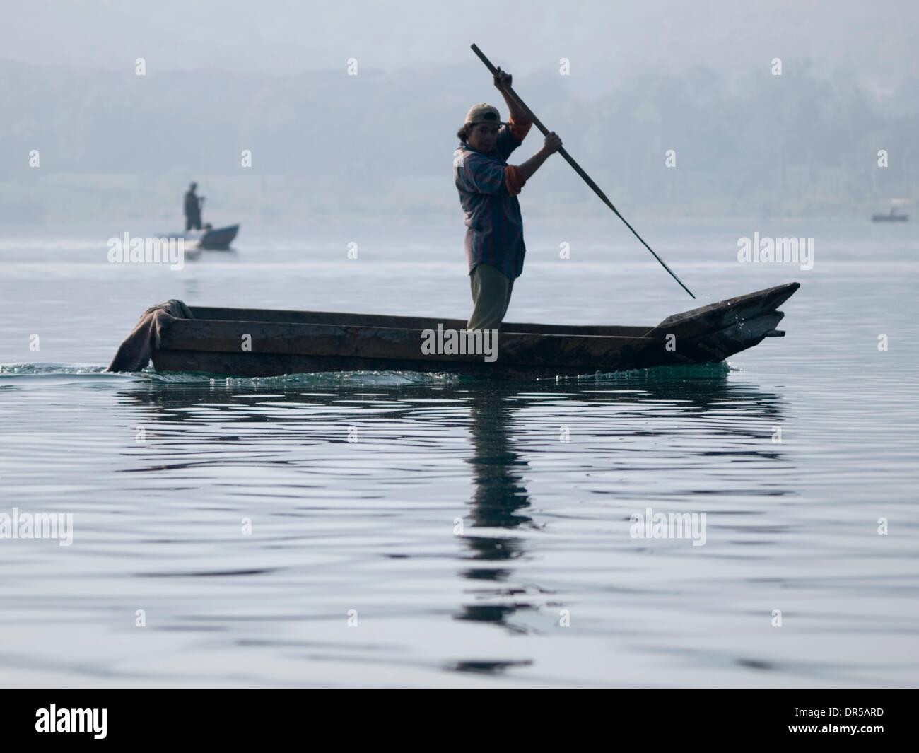 Mar 29, 2009 - Santiago Atitlan, Solola, Guatemala - Fishermen at work on Lake Atitlan in Santiago Atitlan, Solola, Stock Photo