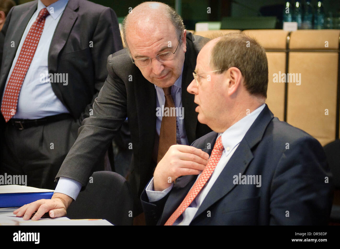 Mar 09, 2009 - Brussels, Belgium - European Monetary Affairs Commissioner, Spanish, JOAQUIN ALMUNIA chats with German Finance Minister PEER STEINBRUECK (R) at the start of an Eurogroup Finance ministers meeting at the European council headquarters. (Credit Image: © Wiktor Dabkowski/ZUMA Press) - Stock Image