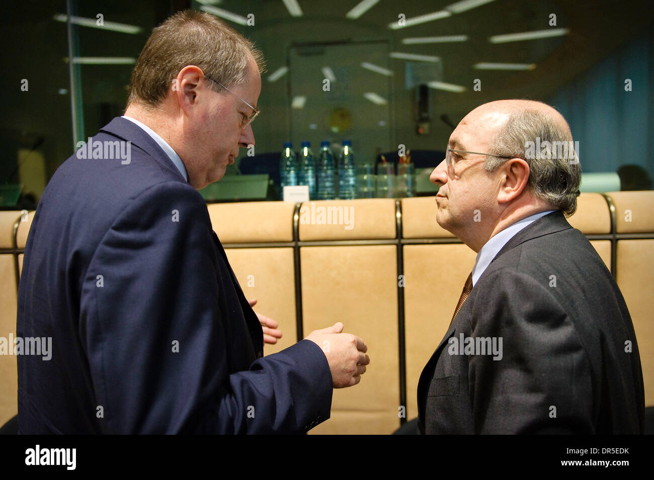Mar 09, 2009 - Brussels, Belgium - European Monetary Affairs Commissioner, Spanish, JOAQUIN ALMUNIA chats with German Finance Minister PEER STEINBRUECK (L) at the start of an Eurogroup Finance ministers meeting at the European council headquarters. (Credit Image: © Wiktor Dabkowski/ZUMA Press) - Stock Image