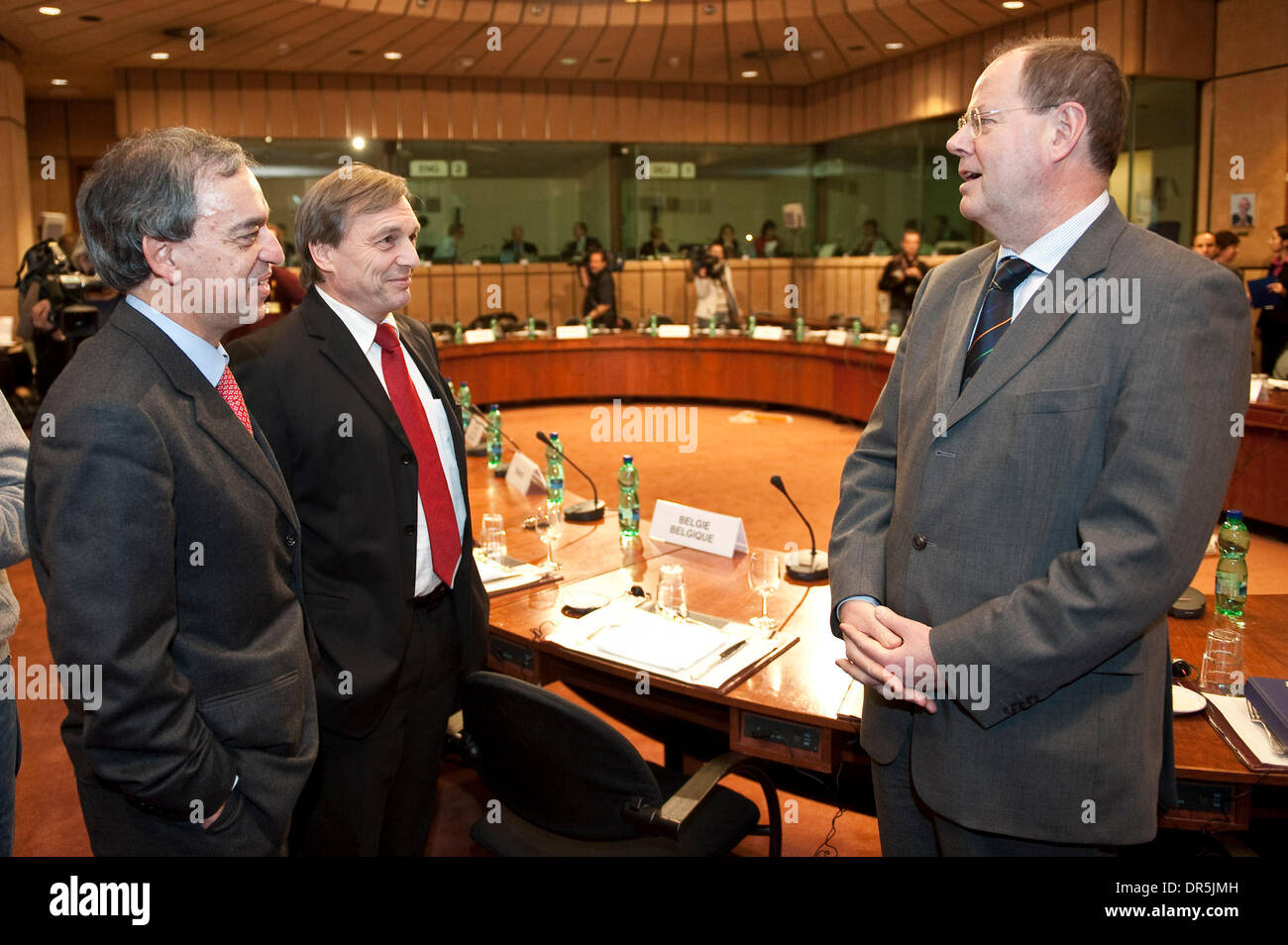 Jan 19, 2009 - Brussels, Belgium - Germany's Finance Minister PEER STEINBRUECK (R) chats with his Cyprus counterpart CHARILAOS STAVRAKIS and Luxembourg counterpart JEANNOT KRECKE (C) at the start of a Eurozone Finance ministers meeting in Brussels (Credit Image: © Wiktor Dabkowski/ZUMA Press) - Stock Image