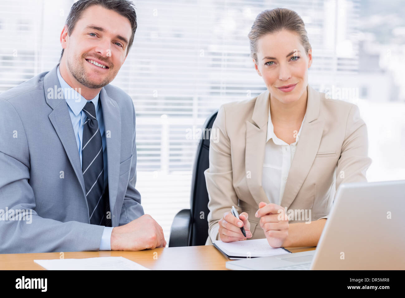Smartly dressed colleagues in business meeting Stock Photo