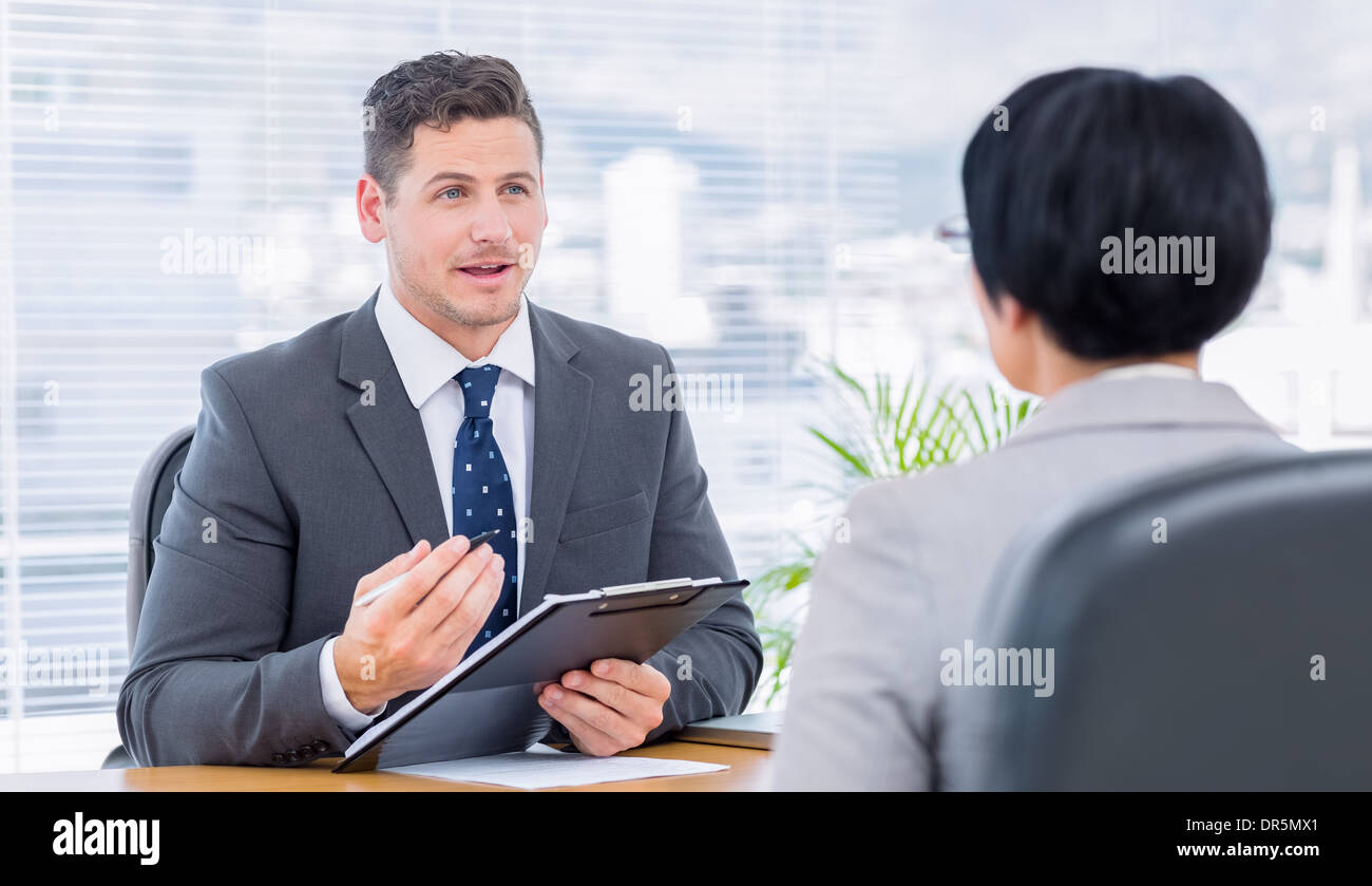 Recruiter checking the candidate during job interview - Stock Image