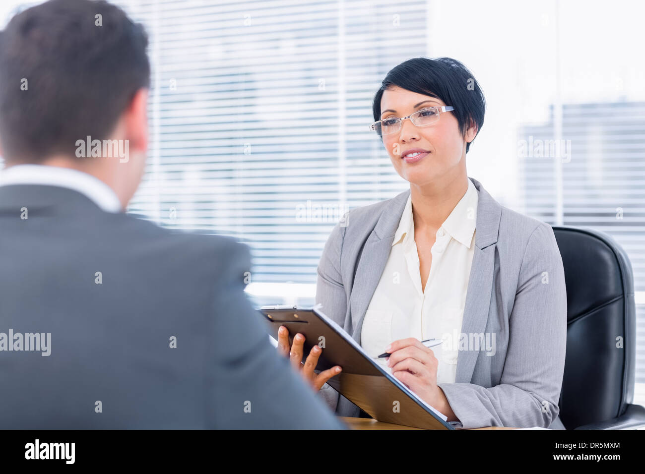 Recruiter checking the candidate during a job interview - Stock Image