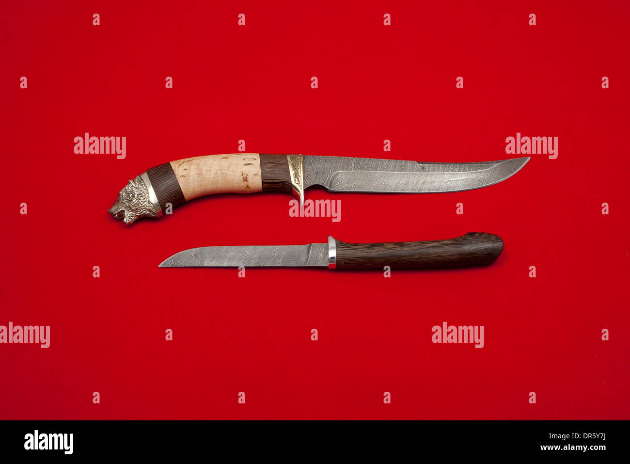 Two knives on red Stock Photo
