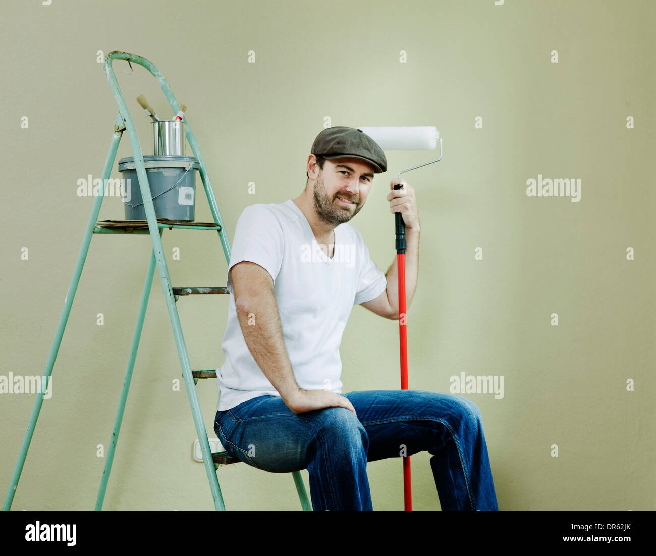 Man decorating, taking a break, Munich, Bavaria, Germany - Stock Image